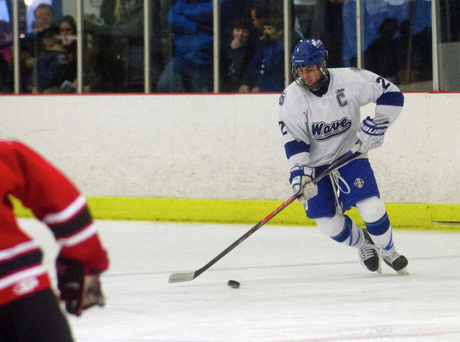 Darien's Nick Allam controls the puck during Saturday's boys hockey game against New Canaan at the Darien Ice Rink in Darien, Conn., on December 28, 2013. Photo: Lindsay Perry / Stamford Advocate