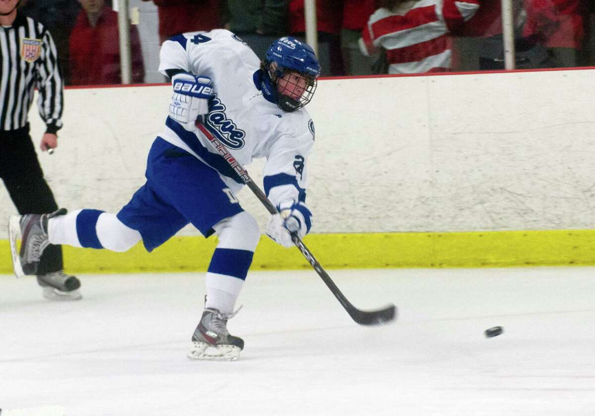 Darien's Dillon Fitzpatrick takes a shot during Saturday's boys hockey game against New Canaan at the Darien Ice Rink in Darien, Conn., on December 28, 2013.