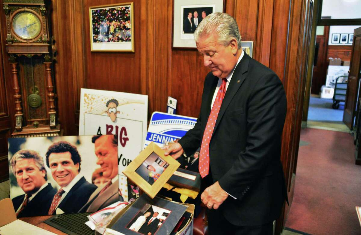 Mayor Jerry Jennings looks over photographs representing over 20 years in office in his office at City Hall Wednesday Dec. 11, 2013, in Albany,NY. (John Carl D'Annibale / Times Union)