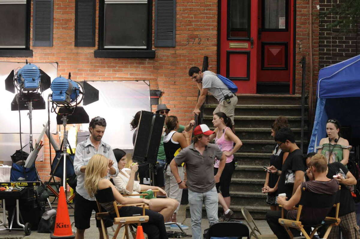 A film production crew set up outside a home at 372 Hamilton Street while a small independent movie by the title of