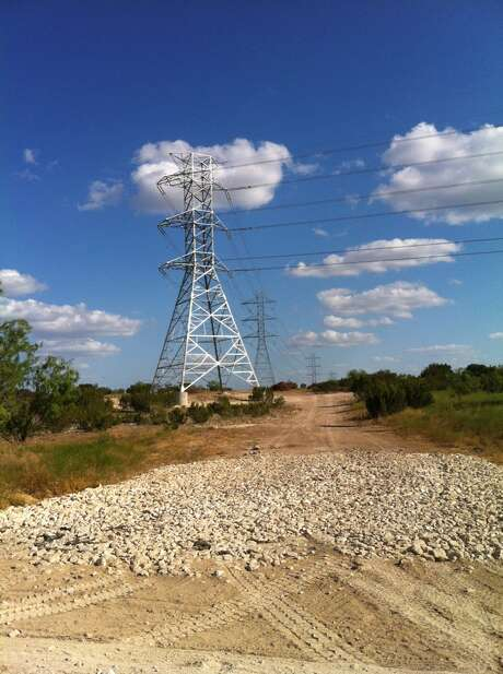 A lattice tower that is part of a new double circuit 140-mile, 345-kV transmission line between the Big Hill and Kendall substations, north of San Antonio, built by The Lower Colorado River Authority, as a section of the Competitive Renewable Energy Zones (CREZ) initiative project. Photo: Lower Colorado River Authority