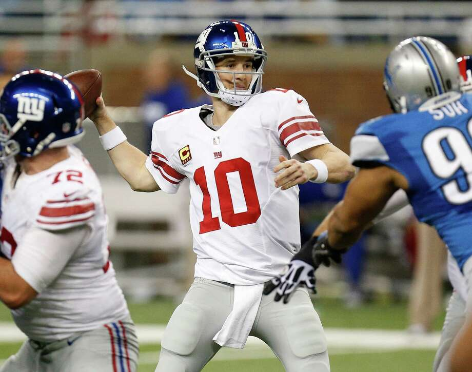 DETROIT, MI - DECEMBER 22: Eli Manning #10 of the New York Giants throws a second quarter pass while playing the Detroit Lions at Ford Field on December 22, 2013 in Detroit, Michigan. (Photo by Gregory Shamus/Getty Images) ORG XMIT: 187472972 Photo: Gregory Shamus / 2013 Getty Images