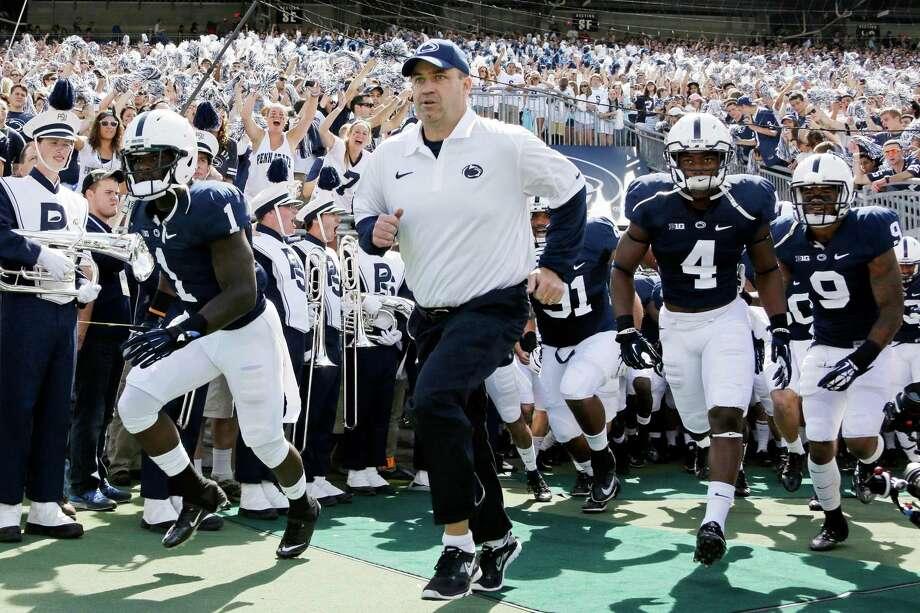 Penn State coach Bill O'Brien is racing the Texans' way. Photo: Gene J. Puskar, STF / AP