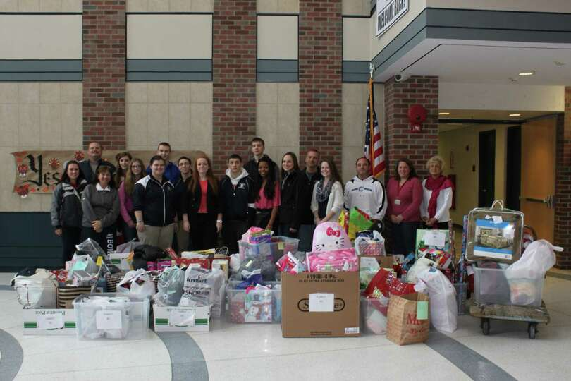 Members of the CHS athletic family spent the last several weeks collecting gifts for Adopt-A-Family