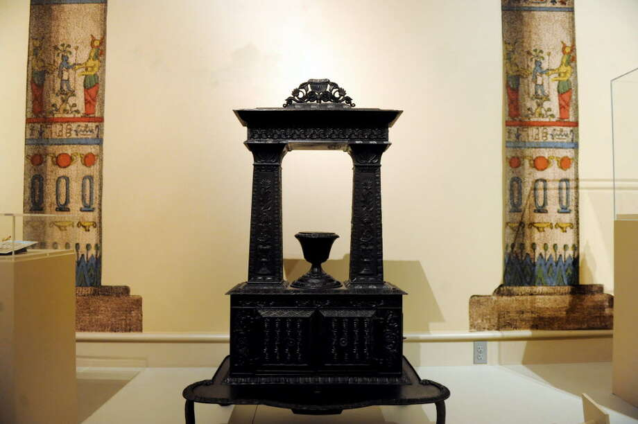 An Egyptian-influenced stove, especially the shape of the columns, made in Albany in the Egyptomanic Room of GE Presents: The Mystery of the Albany Mummies, which opened Sept. 17 and will run until June at the Albany Institute of History and Art. (Cindy Schultz / Times Union)