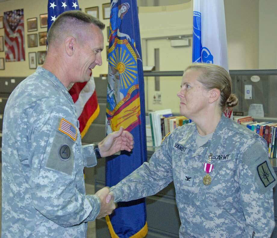 Sgt. Jeremy Bratt / 138th Public Affairs Det. Major Gen. Patrick Murphy, the adjutant general of New York, presents a Meritorious Service Medal to Col. Theresa VanCort during a ceremony in Latham.