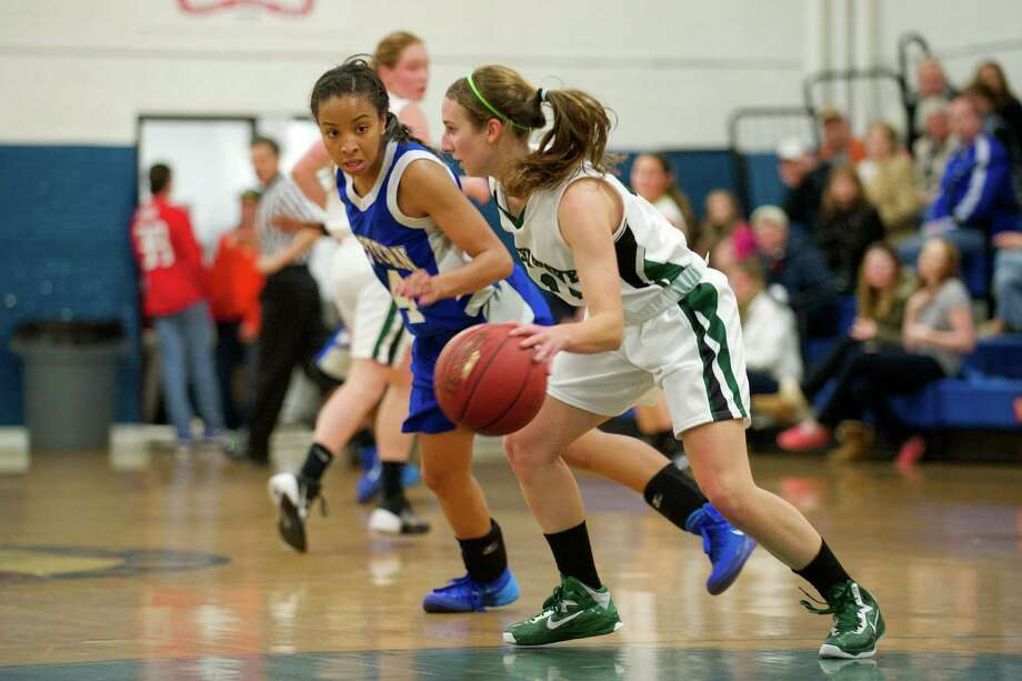 Bristol's Cassie Aiken (4) guards New Milford's Gigi Fusco (11) during the 2013 News-Times Greater Danbury Holiday Festival girls basketball tournament played at the Danbury War Memorial, Danbury, Conn. Consolation  game action between New Milford High School and Bristol Eastern High School on Saturday, December 28, 2013. Bristol Eastern beat New Milford 66 to 54. Photo: H John Voorhees III / The News-Times Freelance