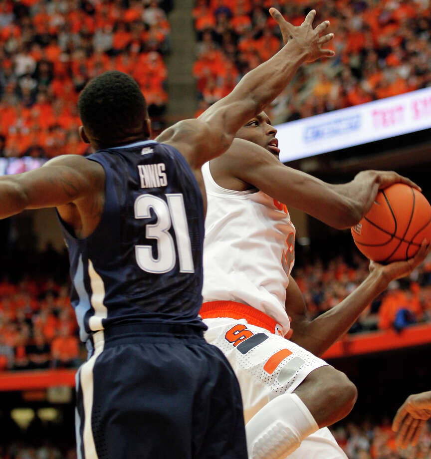 Syracuse's Jerami Grant, right, drives to the basketball against Villanova's Dylan Ennis, left, during the first half of an NCAA college basketball game in Syracuse, N.Y., Saturday, Dec. 28, 2013. (AP Photo/Nick Lisi) ORG XMIT: NYNL103 Photo: Nick Lisi / FR171024 AP