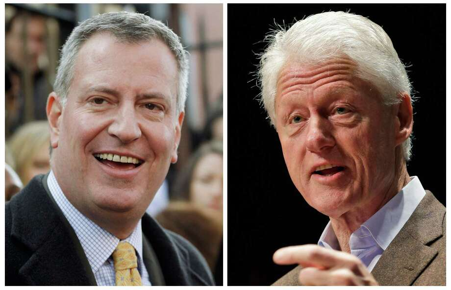 In this combination of two file photos, New York City Mayor-elect Bill de Blasio, left, and former U.S. President Bill Clinton are shown. On Saturday, Dec. 28, 2013, the de Blasio Transition team announced that Bill Clinton will swear him in as New York City's 109th mayor, when de Blasio receives the Oath of Office at New York City Hall on Wednesday, Jan. 1, 2014. (AP Photo/Mark Lennihan, Steve Helber, File) Photo: MArk Lennihan And Steve Helber, STF / AP