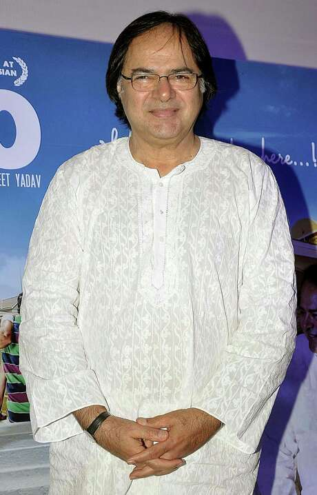 In this Nov. 30, 2013 photo, Indian actor Farooq Shaikh attends a promotional event for his film Club 60 in Mumbai, India. Shaikh, the plump unlikely hero of scores of Bollywood films, has died. He was 65. Press Trust of India reported that Shaikh suffered a heart attack Friday, Dec. 27, 2013, in Dubai, where he was visiting with his family. (AP Photo/Sunil Khandare) Photo: Sunil Khandare, STR / AP