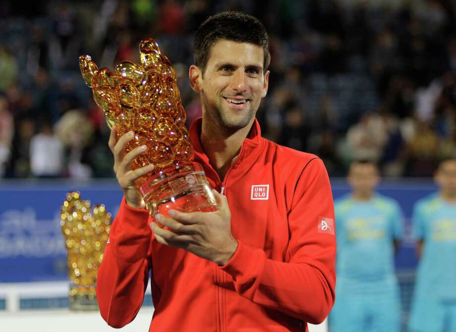 Novak Djokovic of Serbia holds the trophy after he beat David Ferrer of Spain during the final match of the Mubadala World Tennis Championship in Abu Dhabi, United Arab Emirates, Saturday, Dec. 28, 2013. (AP Photo/Kamran Jebreili) ORG XMIT: XKJ110 Photo: Kamran Jebreili / AP
