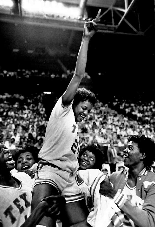 Texas forward Davis is lifted by her teammates March 30, 1986, after they defeated USC 94-78 to win the NCAA Women's Championship. Davis was named Most Valuable Player in the tournament. In 1987, Davis, a sophomore, won the Naismith Award for college player of the year, and won a gold medal in the Pan American Games. Photo: GARY LANDERS, Gary Landers/Associated Press / AP