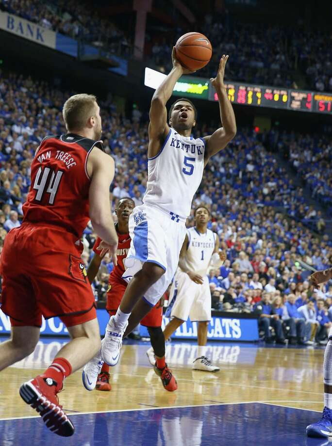Andrew Harrison (5), a product of Fort Bend Travis, had 18 points Saturday to lead No. 18 Kentucky to a 73-66 win over state rival and sixth-ranked Louisville. Photo: Andy Lyons, Staff / 2013 Getty Images