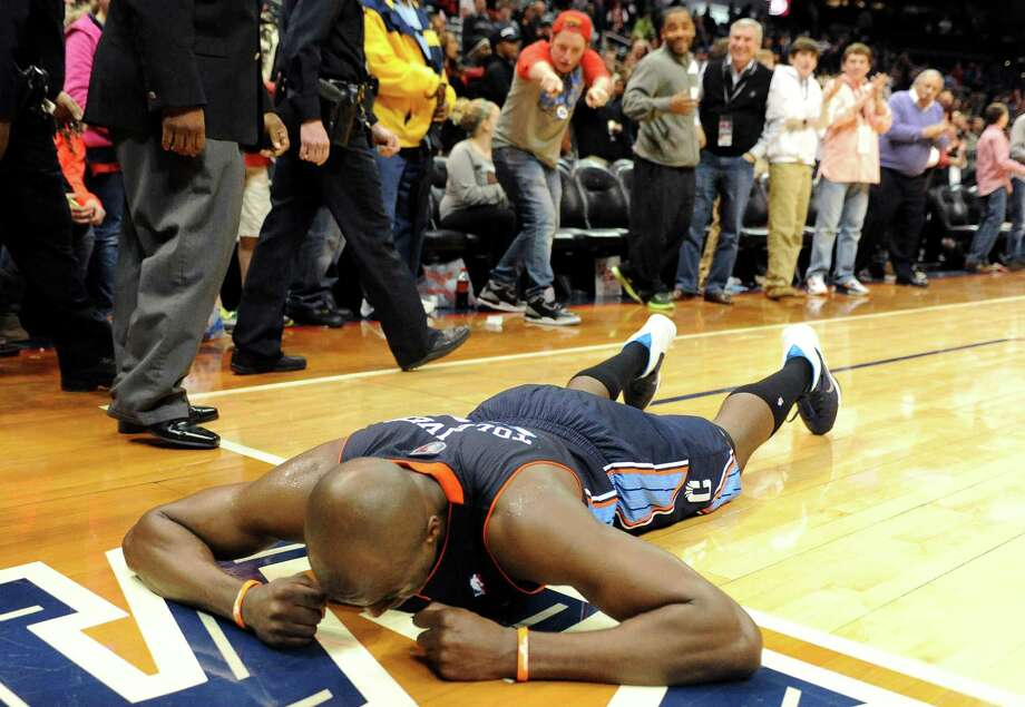 A visibly distraught Anthony Tolliver was floored by his Bobcats' overtime loss to the Hawks on Saturday after Charlotte blew a double-digit, second-half lead. Photo: Dave Tulis, FRE / FR170493 AP
