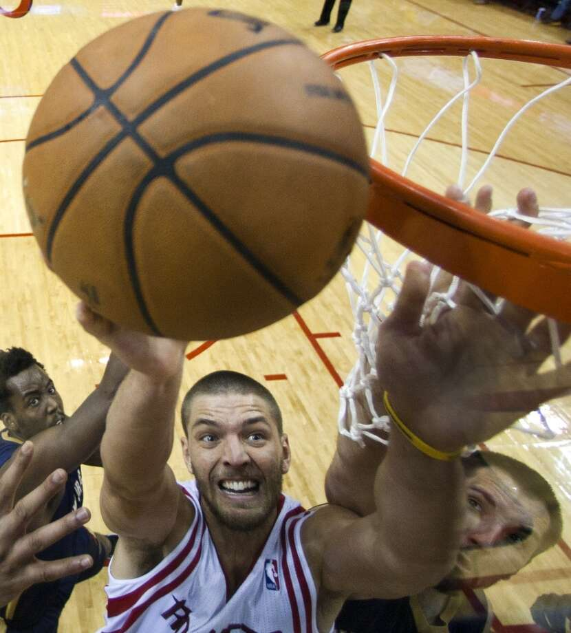 Dec. 28: Rockets 107, Pelicans 98  Rockets small forward Chandler Parsons (25) shoots a layup with Pelicans power forward Ryan Anderson (33) defending. Photo: Brett Coomer, Houston Chronicle