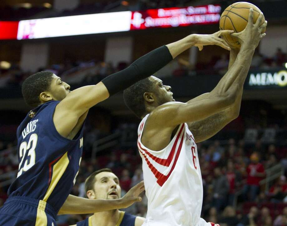 Pelicans power forward Anthony Davis (23) defends a shot by Rockets power forward Terrence Jones. Photo: Brett Coomer, Houston Chronicle