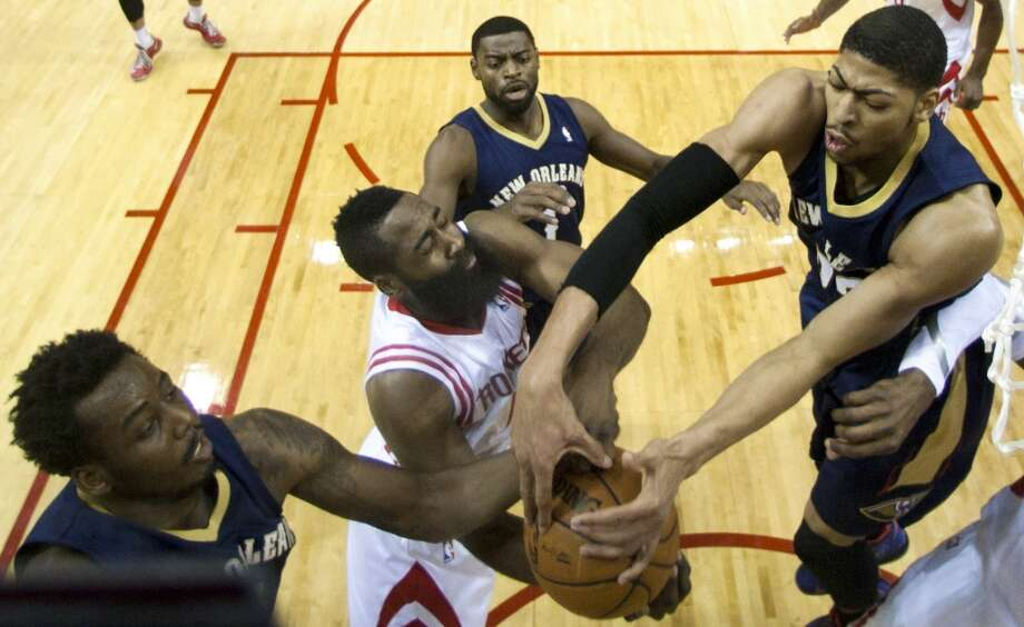 Rockets shooting guard James Harden (13) battles for a rebound with Pelicans small forward Al-Farouq Aminu (0) and Pelicans power forward Anthony Davis (23). Photo: Brett Coomer, Houston Chronicle