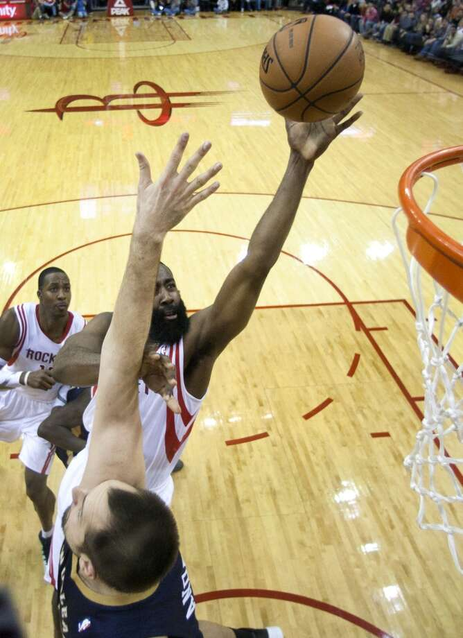 Rockets shooting guard James Harden (13) drives to the basket against Pelicans power forward Ryan Anderson. Photo: Brett Coomer, Houston Chronicle