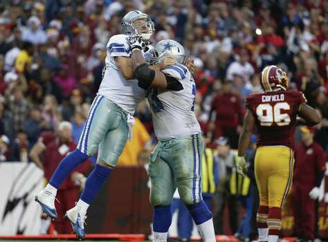 Former Cowboys QBs Troy Aikman and Babe Laufenberg wonder if Tony Romo, being lifted by Mackenzy Bernadeau in last week's victory against Washington, will even play again. Photo: Alex Brandon / Associated Press / AP