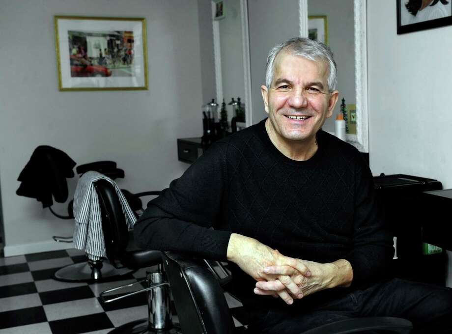 Naser Behluli, 56, owns  Naser's Salon in Newtown. Photo: Carol Kaliff / The News-Times