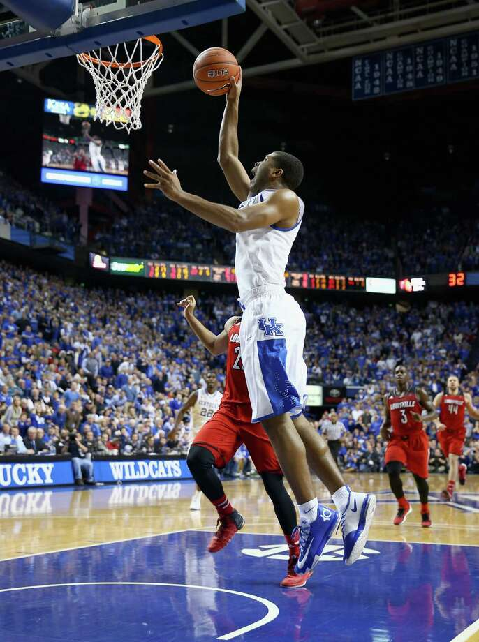 LEXINGTON, KY - DECEMBER 28:  Aaron Harrison #2 of the Kentucky Wildcats shoots the ball during 73-66 win over the Louisville Cardinals at Rupp Arena on December 28, 2013 in Lexington, Kentucky.  (Photo by Andy Lyons/Getty Images) ORG XMIT: 183571224 Photo: Andy Lyons / 2013 Getty Images