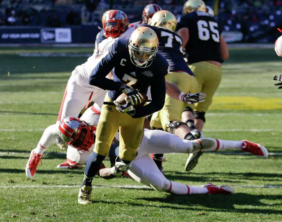 Notre Dame wide receiver TJ Jones (7) runs past Rutgers's Kevin Snyder for a touchdown during the first half of the Pinstripe Bowl NCAA college football game Saturday, Dec. 28, 2013, at Yankee Stadium in New York. (AP Photo/Frank Franklin II) ORG XMIT: NYY113 Photo: Frank Franklin II / AP