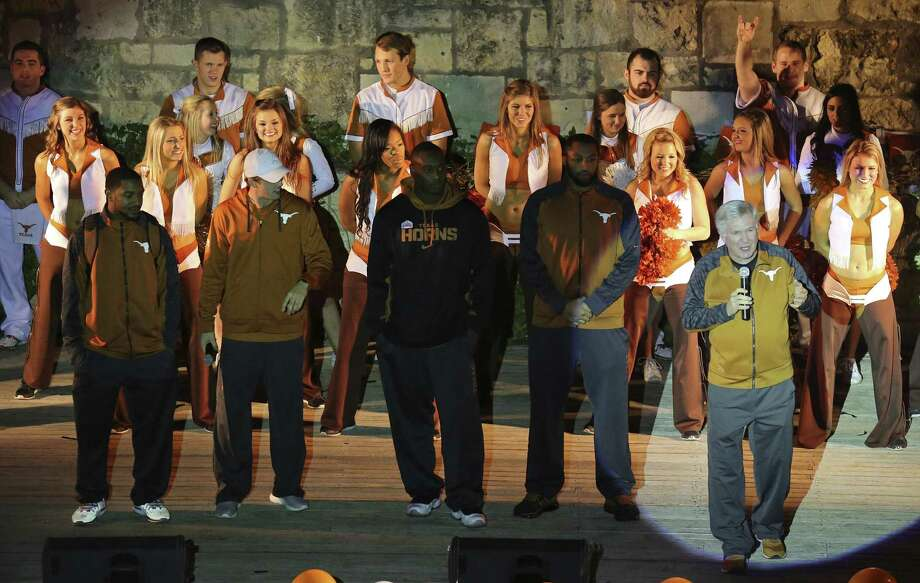 Texas Longhorns football players and cheerleaders listen to head football coach Mack Brown (right) speak during an Alamo Bowl pep rally Saturday at the Arneson River Theatre. Photo: Edward A. Ornelas / San Antonio Express-News / © 2013 San Antonio Express-News