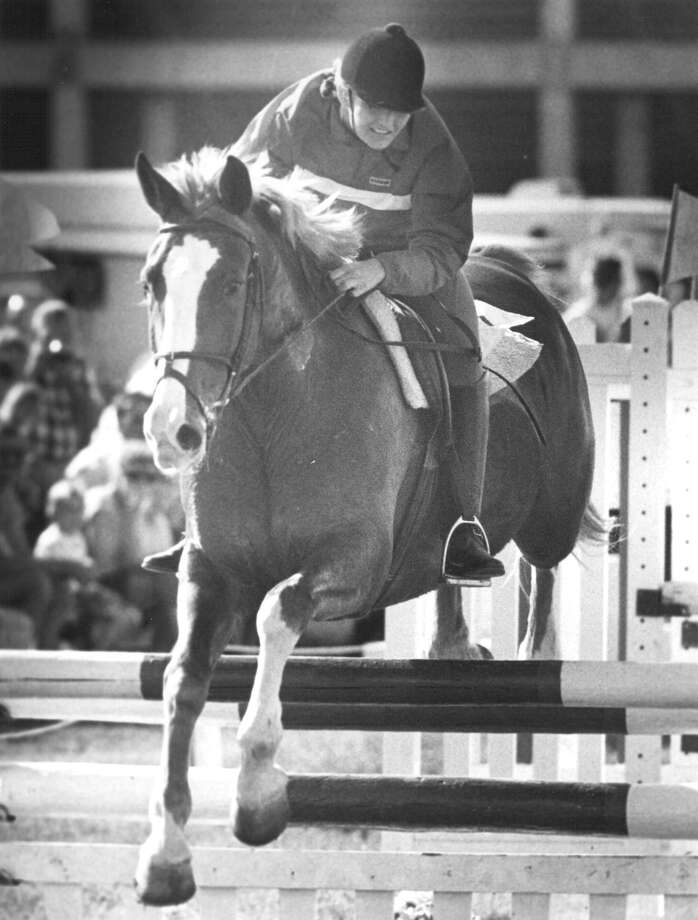 Norwood — seen here in 1990 — was the 1989 World Champion in the Modern Pentathlon, and the first American woman to win an individual world pentathlon championship. A pentathlon consists of five sports: fencing,  200-meter freestyle swimming, show jumping, pistol shooting and a 3,200-meter cross-country run. Photo: San Antonio Express-News