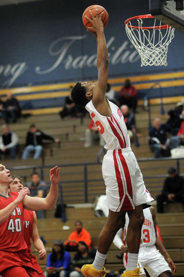 North Shore's Jarrey Foster goes up for a dunk in front of The Woodlands' Garrett Smith. Photo: Jerry Baker, Freelance