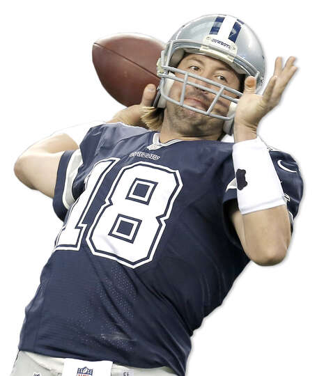 FILE - In this Nov. 28, 2013, file photo, Dallas Cowboys quarterbacks Kyle Orton (18) warms up as an
