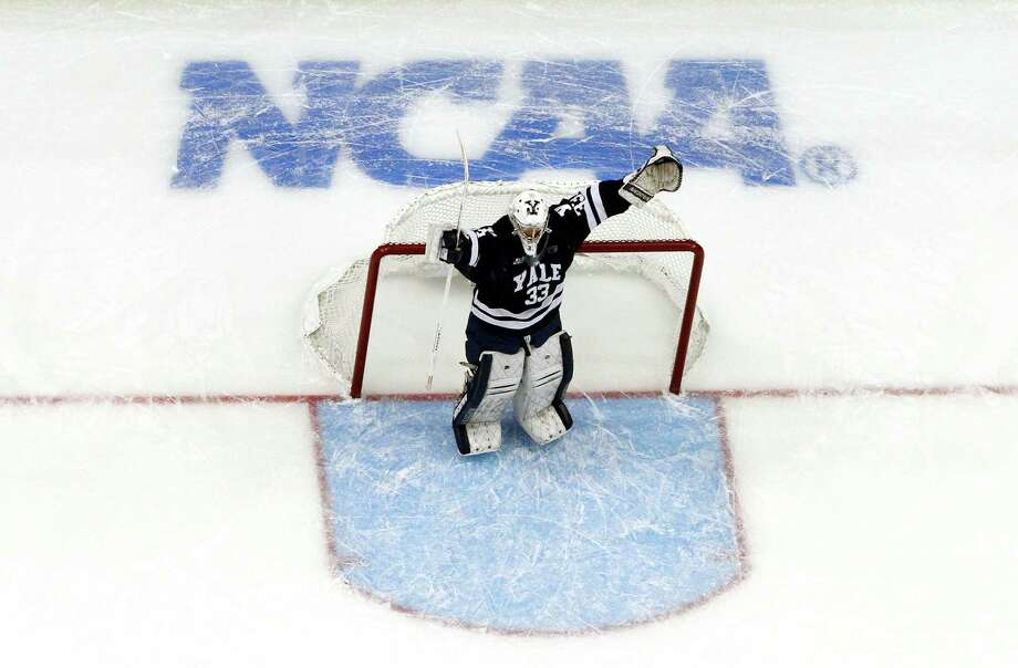 PITTSBURGH, PA - APRIL 13:  Jeff Malcolm #33 of the Yale Bulldogs celebrates after defeating the Quinnipiac Bobcats in the Men's Ice Hockey National Championship game at Consol Energy Center on April 13, 2013 in Pittsburgh, Pennsylvania.  Yale defeated Quinnipiac 4-0. Photo: Justin K. Aller, Getty Images / 2013 Getty Images