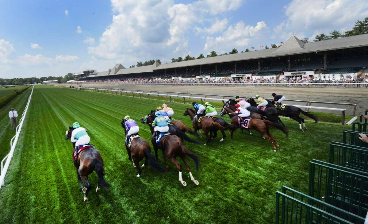 The 150th race meeting kicks off at the first race on the card breaks from the gate on opening day July 19, 2013, at Saratoga Race Course in Saratoga Springs, N.Y. (Skip Dickstein/Times Union)