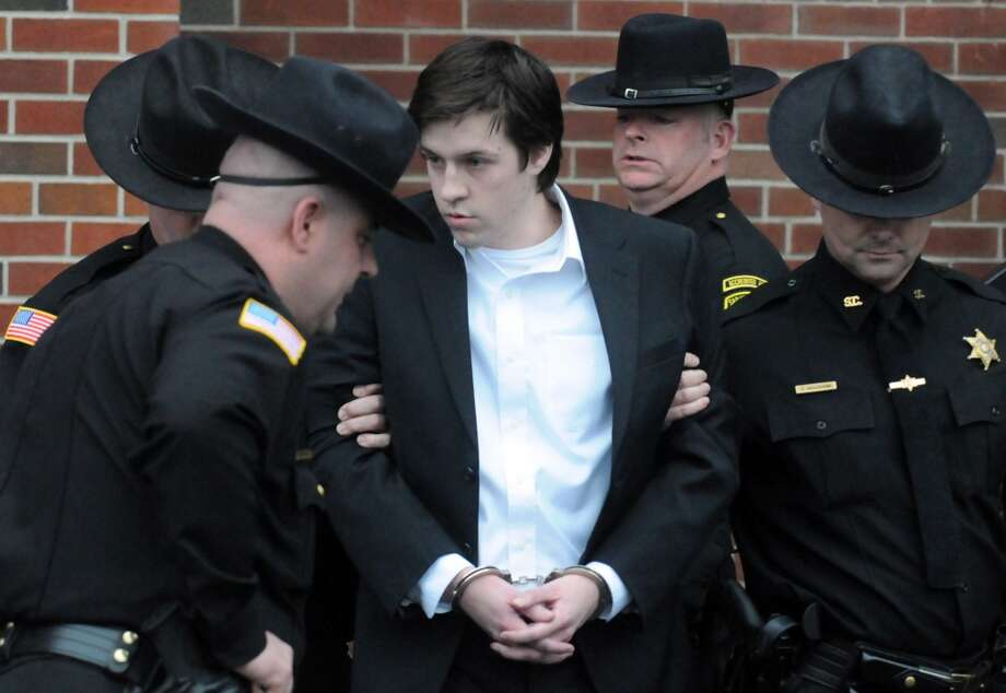 Dennis Drue is led out of the Saratoga County Court House by Saratoga Sheriff deputies following his sentencing Dec. 5, 2013, in Ballston Spa, N.Y. Drue was sentenced to 5-15 years after pleading guilty to felony charges regarding the Northway crash which killed Chris Stewart and Deanna Rivers. (Michael P. Farrell/Times Union) Photo: Albany Times Union
