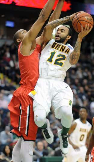 Siena's Rakeem Brookins drives to the basket against Fairfield's Keith Matthews during a basketball