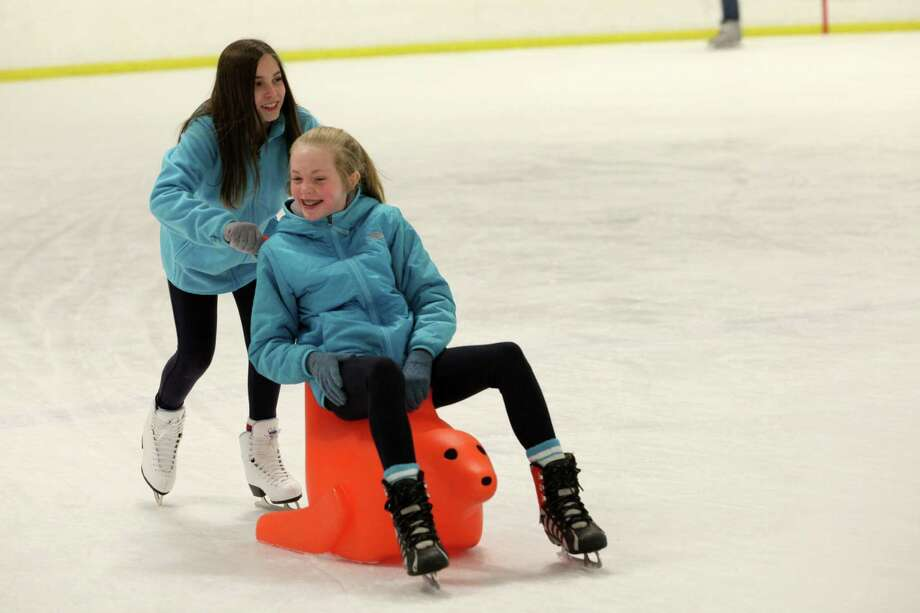 Lauren Shuster pushes Emma Eckel, both 12 of Fairfield, on a seal at the Wonderland of Ice in Bridgeport, Conn. on Sunday, Dec. 29, 2013. Photo: BK Angeletti, B.K. Angeletti / Connecticut Post freelance B.K. Angeletti