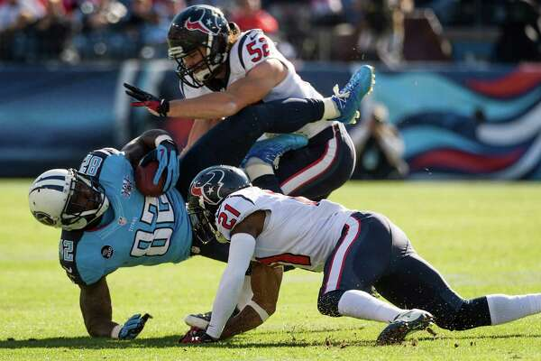 Tennessee Titans tight end Delanie Walker (82) is upended by Houston Texans cornerback Brice McCain (21) and middle linebacker Jeff Tarpinian (52) during the first half of an NFL football game on Sunday, Dec. 29, 2013, in Nashville.