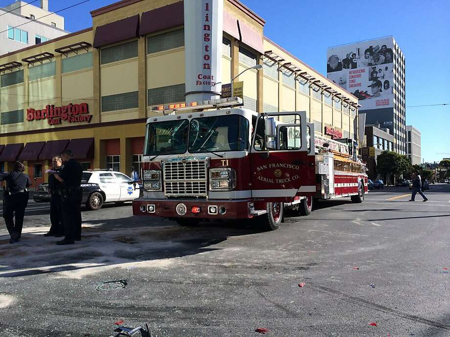 In this file photo, a San Francisco Fire Department truck collided with a Mercedes-Benz station wagon in the intersection of 5th and Howard Street in December 2013.  A fire truck collided with a motorcycle in the same intersection in June 2013. Photo: Jason Lloren, The Chronicle