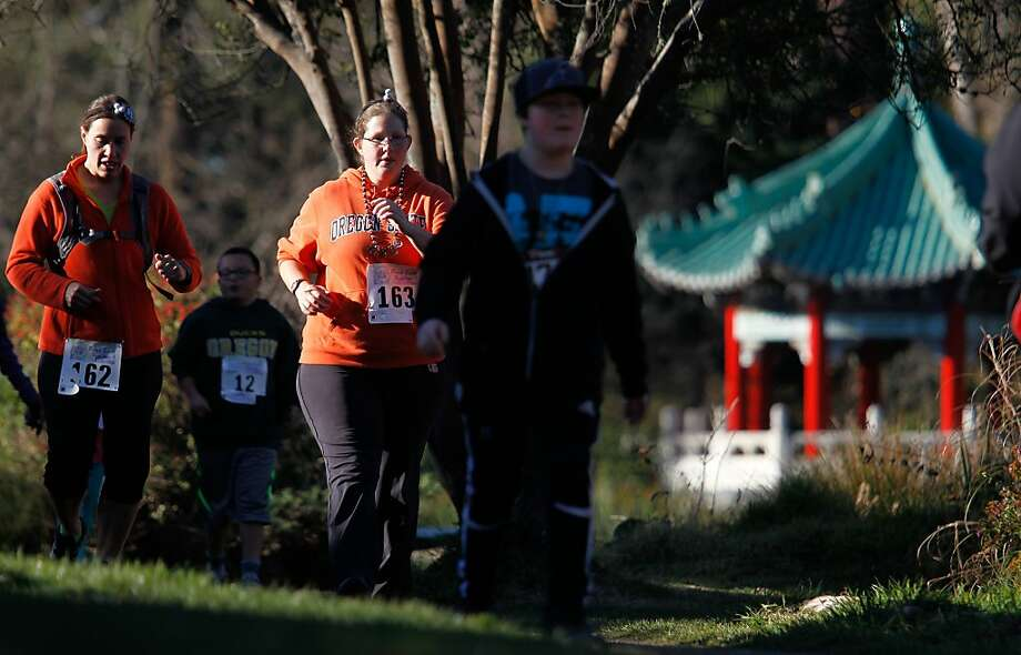 Sisters Erin (162) and Jessica (163) Walker run with others around Stow Lake in the third annual Resolution Dash 5K. Photo: Mathew Sumner, Special To The Chronicle