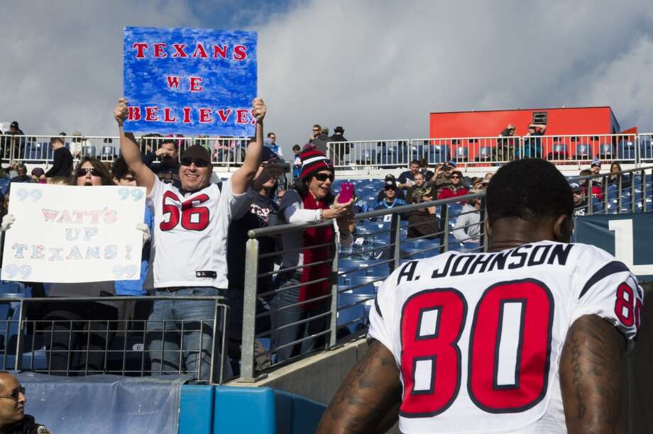 Texans fans cheer wide receiver Andre Johnson before the game. Photo: Smiley N. Pool, Houston Chronicle