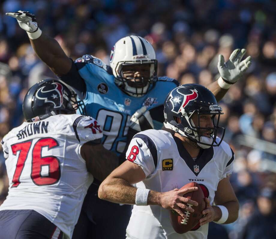 Texans quarterback Matt Schaub is pressured by Titans defensive end Kamerion Wimbley. Photo: Smiley N. Pool, Houston Chronicle