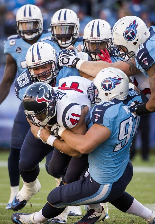 Texans running back Jonathan Grimes is wrapped up by the Titans defense. Photo: Smiley N. Pool, Houston Chronicle