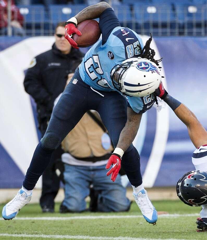 Titans running back Chris Johnson scores past Texans free safety Shiloh Keo on an 11-yard touchdown run. Photo: Smiley N. Pool, Houston Chronicle