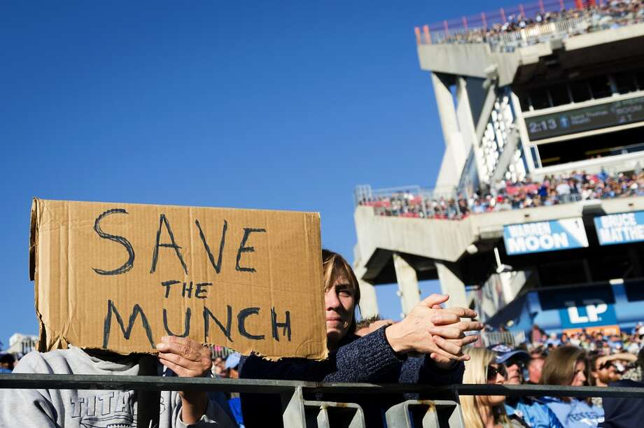 Titans fans hold a sign showing support for head coach Mike Munchak. Photo: Smiley N. Pool, Houston Chronicle