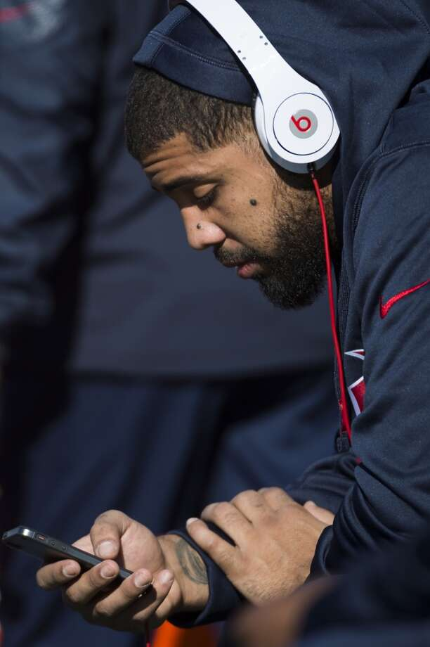 Injured Texans running back Arian Foster sits on the bench before the game. Photo: Smiley N. Pool, Houston Chronicle