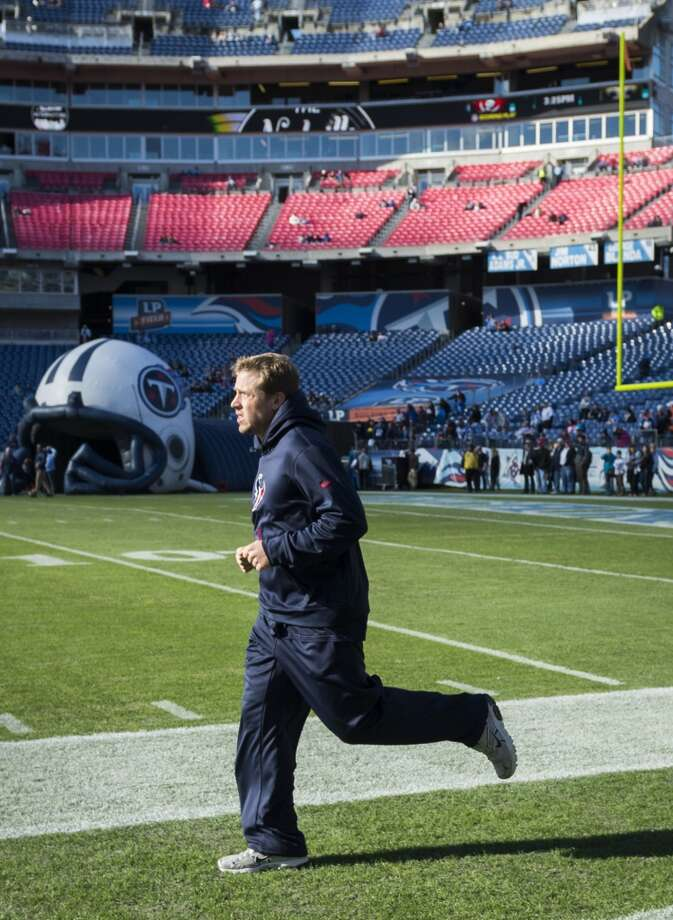 Texans quarterback Case Keenum jogs before Houston's matchup with the Titans. Photo: Smiley N. Pool, Houston Chronicle