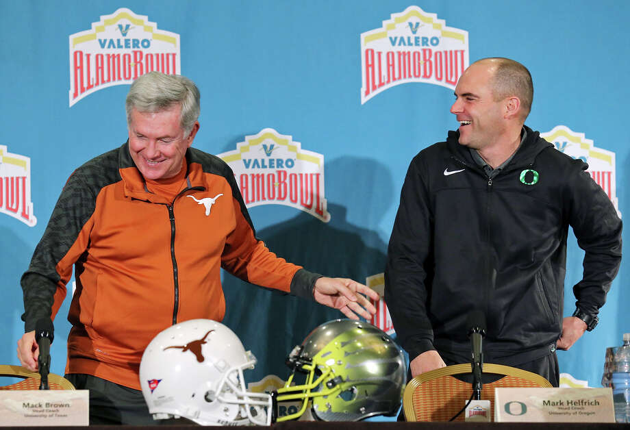 Texas and Oregon will provide quite a contrast when they meet tonight in the Valero Alamo Bowl. Click ahead to see Express-News college football writer Tim Griffin's take on how the schools are alike, and how they differ. Which school comes out on top? You decide. Texas Longhorns head coach Mack Brown (left) and Oregon Ducks head coach Mark Helfrich joke after a press conference Sunday Dec. 29, 2013 at the Marriott Riverwalk. The Longhorns and Ducks will play in the Valero Alamo Bowl Monday Dec. 30, 2013 at the Alamodome. Photo: Edward A. Ornelas, San Antonio Express-News / © 2013 San Antonio Express-News