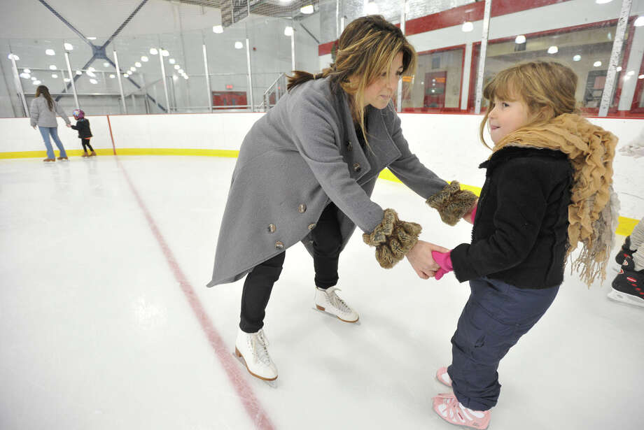 Jennifer Campbell and her daughter, Alexis, skate around the rink during the public skating session at Dorothy Hamill Skating Rink in Greenwich, Conn., on Sunday, Dec. 29, 2013. Photo: Jason Rearick / Stamford Advocate