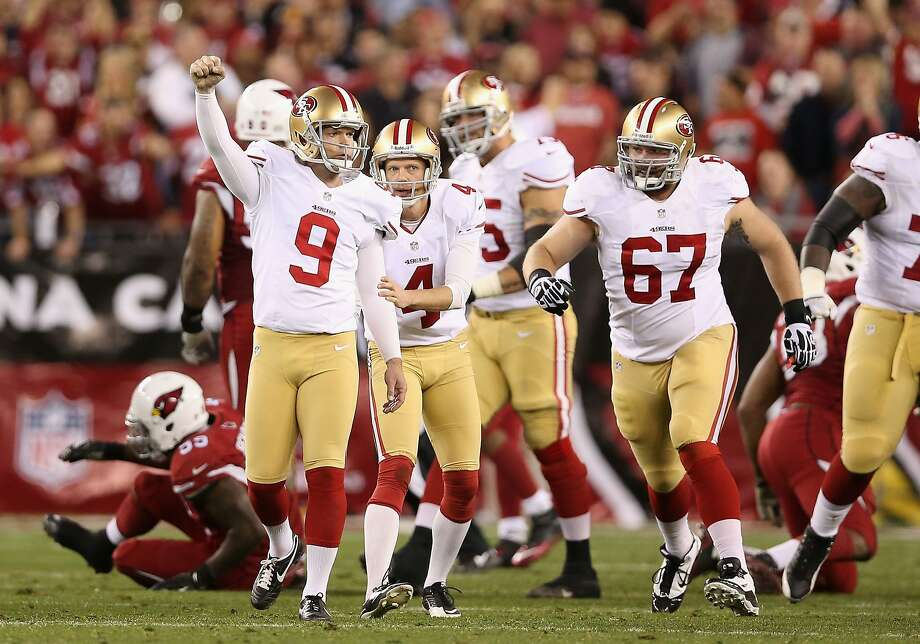 Kicker Phil Dawson #9 of the San Francisco 49ers celebrates after kicking the game winning 40 yard field goal against the Arizona Cardinals during the final moments of the NFL game at the University of Phoenix Stadium on December 29, 2013 in Glendale, Arizona. The 49ers defeated the Cardinals 23-20. Photo: Christian Petersen, Getty Images