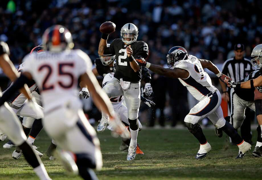 Terrelle Pryor started nine games for the Raiders in 2013, including the season finale against Denver (above), and threw seven touchdown passes and 11 interceptions. Photo: Ezra Shaw, Getty Images