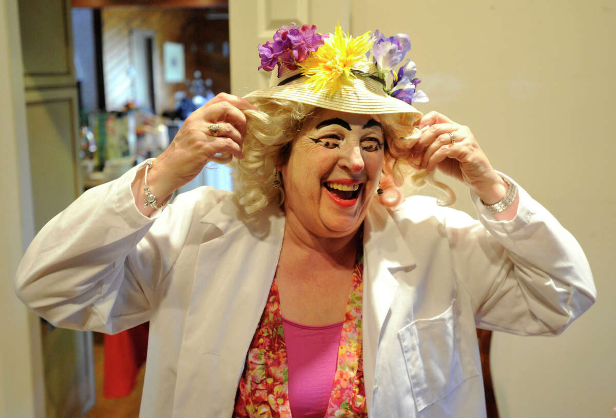 Lorraine Kweskin laughs as she demonstrates how she plays Nurse Morning Glory, a clown character, at her home in Stamford, on Nov. 25. Kweskin is a volunteer with The HAHA Clowns at Stamford Hospital. HAHA stands for Health And Humor Associates.